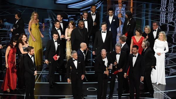 HOLLYWOOD, CA - FEBRUARY 26: 'La La Land' producer Jordan Horowitz (C) stops the show to announce the actual Best Picture winner as 'Moonlight' following a presentation error with actor Warren Beatty and host Jimmy Kimmel (both R) onstage during the 89th Annual Academy Awards at Hollywood & Highland Center on February 26, 2017 in Hollywood, California.   Kevin Winter/Getty Images/AFP